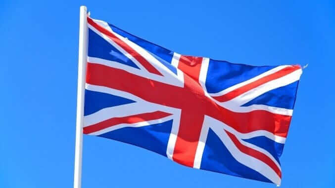 Union jack flag against a blue sky, UK.