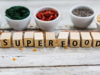 Superfood and healthy food on wooden background. Organic food.