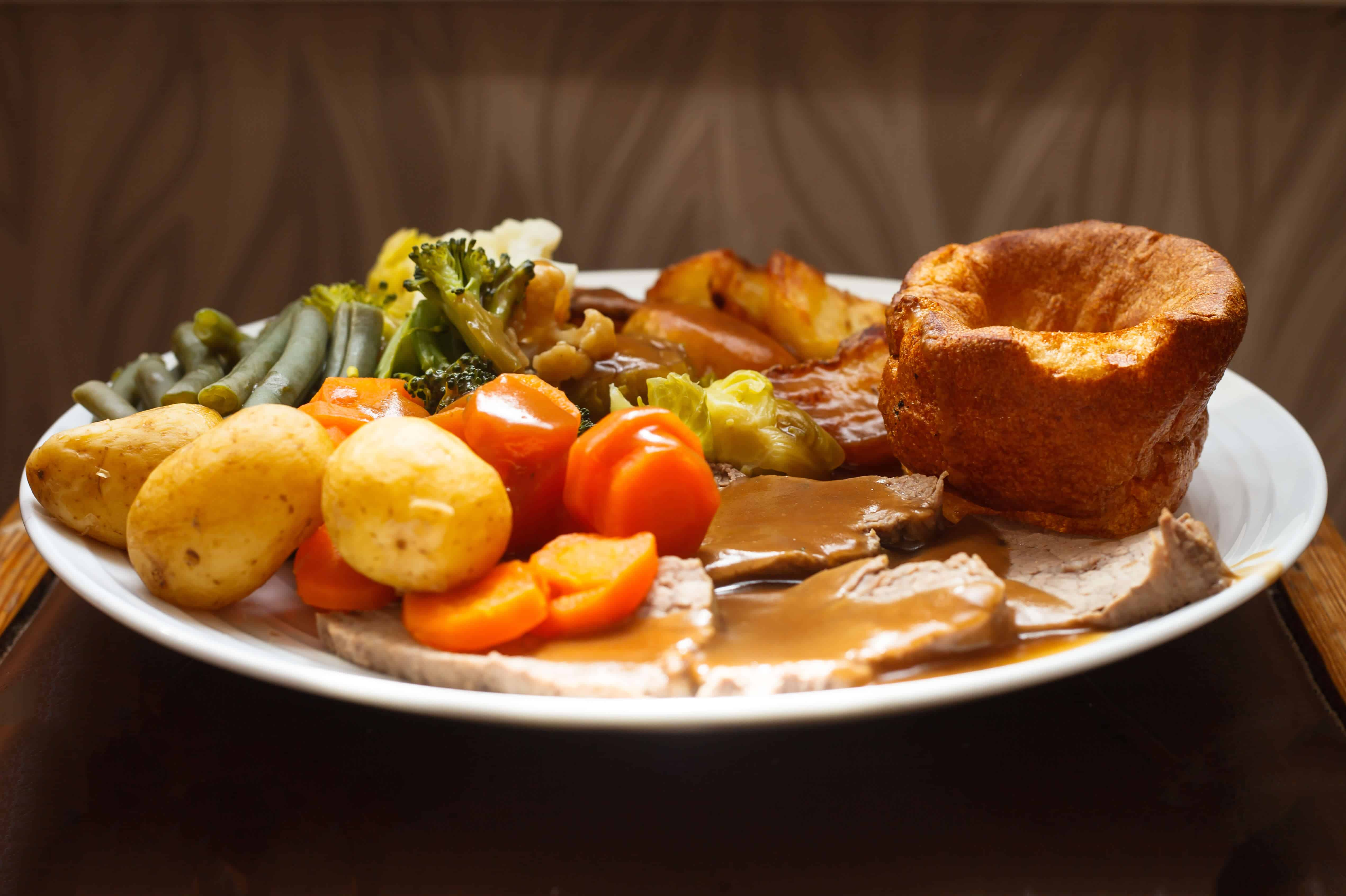 Traditional British roast beef and Yorkshire pudding dinner