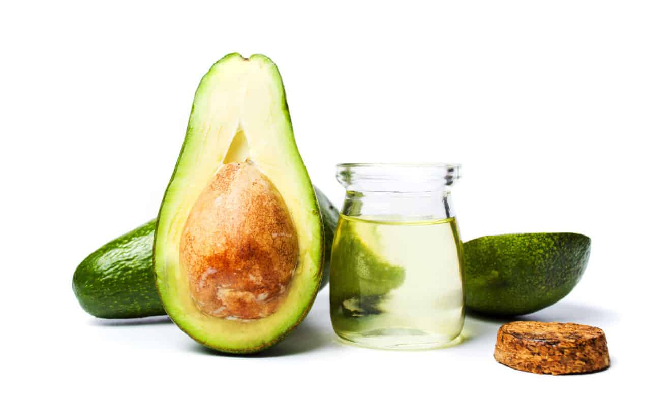 Avocado fruit and oil on white background