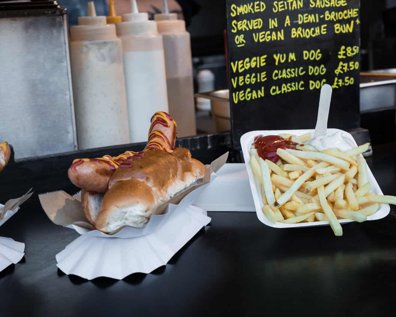Vegan hot dog and french fries in Camden Town Market stand, London